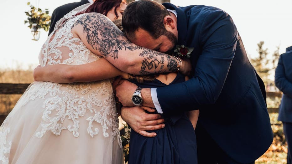 The moment, which was shared on the photography Facebook page, drew in nearly 2K reaction with many sharing comments that the sweet gesture left them in tears, as well. (Abigail Gingerale Photography)