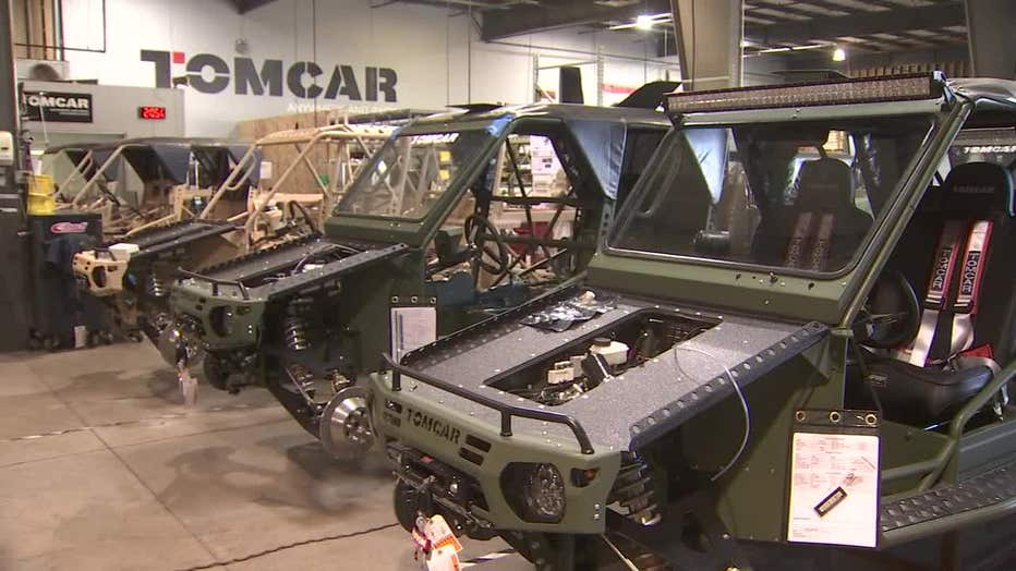 Photo of two unfinished Tomcars in a factory