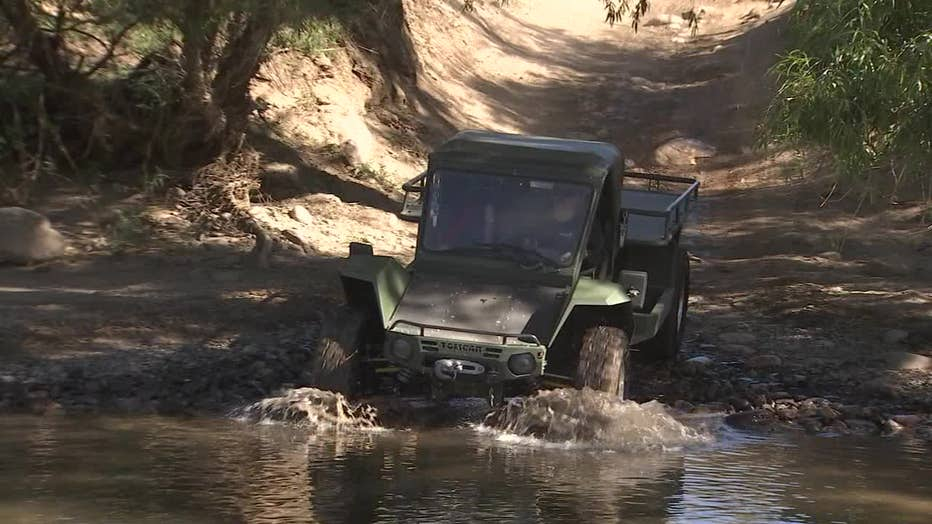 Photo of a finished Tomcar about to ford a creek