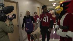Kenyan Drake, other Arizona Cardinals players visit kids at Phoenix Children's Hospital to spread holiday joy