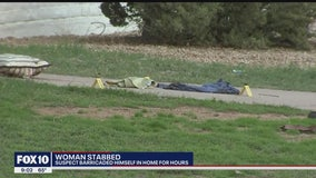 Woman found stabbed in front of a Phoenix home, police say