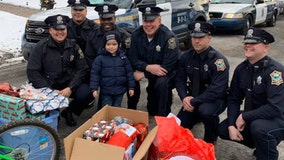 Police officers deliver gifts to 4-year-old whose mother was recently murdered