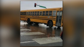 Yellow bus slides sideways down Minnesota road