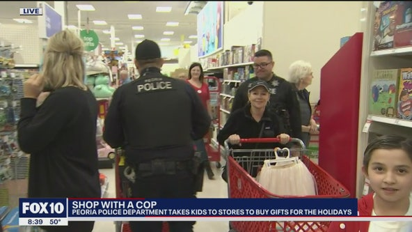 Annual Shop with a Cop event with Peoria Police