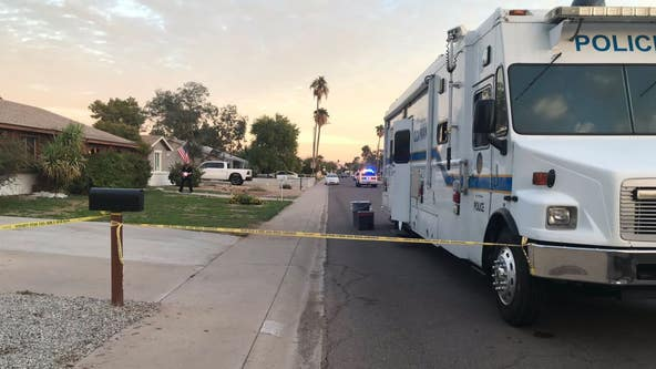Woman fatally stabbed by son in front of Phoenix home, police say