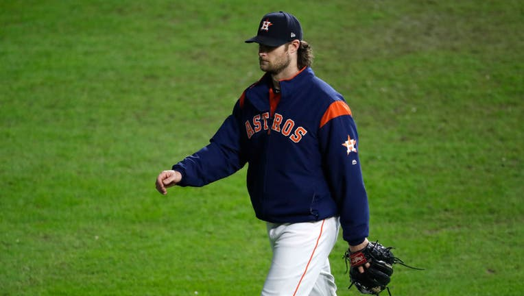 HOUSTON, TEXAS - OCTOBER 30: Gerrit Cole #45 of the Houston Astros walks to the bullpen during the fifth inning against the Washington Nationals in Game Seven of the 2019 World Series at Minute Maid Park on October 30, 2019 in Houston, Texas. (Photo by Tim Warner/Getty Images)