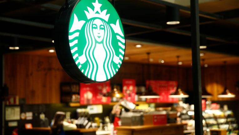 LISBON PORTELA AIRPORT, LISBON, PORTUGAL - 2019/12/11: Starbucks coffee restaurant logo seen at Lisbon Portela Airport. (Photo by Sergei Mikhailichenko/SOPA Images/LightRocket via Getty Images)