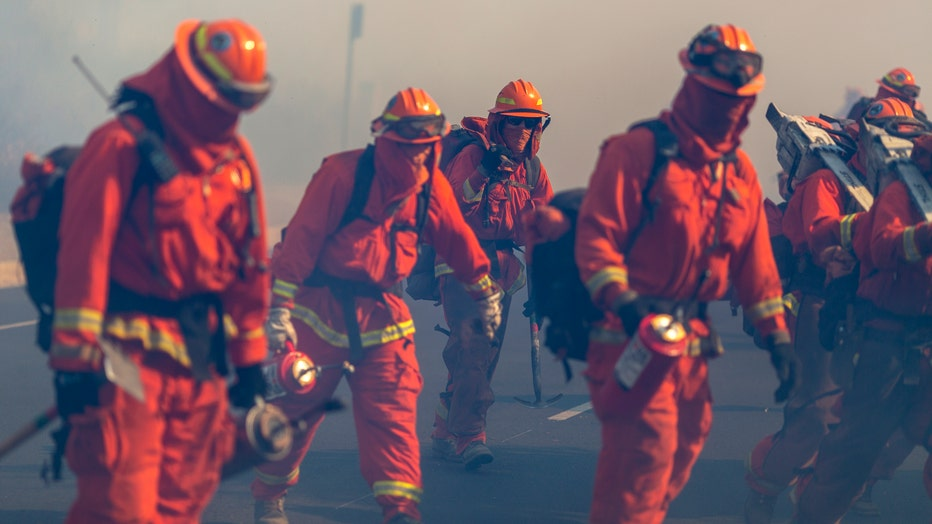 SIMI VALLEY, CA - OCTOBER 30: Inmate firefighters from Oak Glen Conservation Camp near Yucaipa, California fight the Easy Fire on October 30, 2019 near Simi Valley, California. The National Weather Service issued a rare extreme red flag warning for Southern California for gusts that could be the strongest in more than a decade, exceeding 80 mph, as the fast-moving brush fire threatens the Ronald Reagan Presidential Library and nearby residential neighborhoods. (Photo by David McNew/Getty Images)