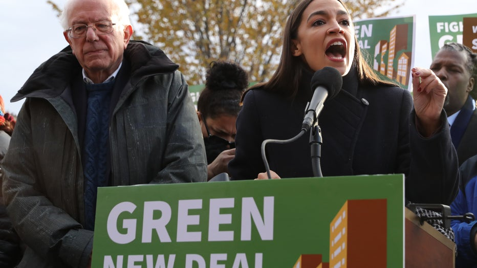 Democratic presidential candidate Sen. Bernie Sanders (I-VT) (L) and Rep. Alexandria Ocasio-Cortez (D-NY) hold a news conference to introduce legislation to transform public housing as part of their Green New Deal proposal outside the U.S. Capitol.