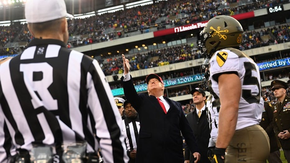 GettyImages-Donald-Trump-coin-toss-Army-Navy-2019.jpg
