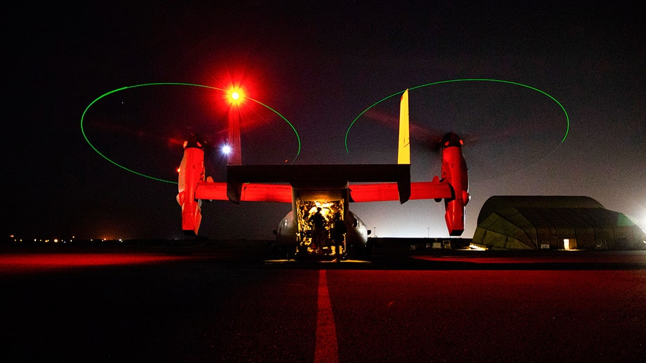 U.S. Marines assigned to Special Purpose Marine Air-Ground Task Force-Crisis Response-Central Command in Kuwait board an MV-22 Osprey bound for Baghdad, Iraq, Dec. 31, 2019.