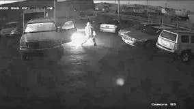 Police: Surveillance video captures man setting cars on fire in parking lot
