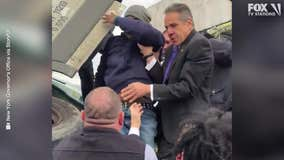 Cuomo helps rescue man from crash on highway