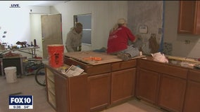 Volunteers busy at work to make disabled vet's home more accessible