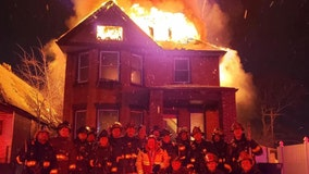 Michigan homeowners enraged over firefighters' group pic outside burning house