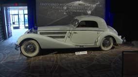 Potential buyers gather for collector car auction at the Biltmore