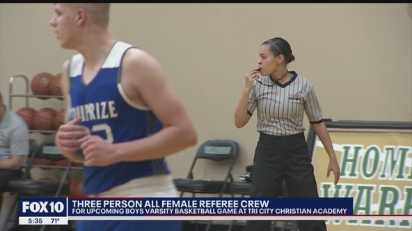 3-person all-female referee crew ready for action during boy's basketball game