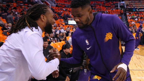 Cardinals wide receiver Larry Fitzgerald purchases minority stake in Phoenix Suns