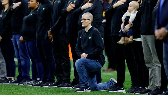 'Teacher of the Year' kneels during anthem at college football championship: 'A very respectful protest'
