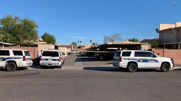 PD: Man with large knife shot, killed by another man at Phoenix apartments
