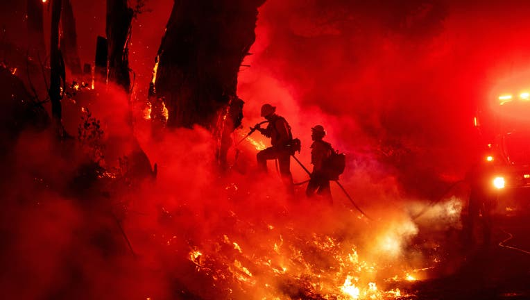 TOPSHOT - Firefighters work to control flames from a backfire during the Maria fire in Santa Paula, California on November 1, 2019. (Photo by Josh Edelson / AFP) (Photo by JOSH EDELSON/AFP via Getty Images)