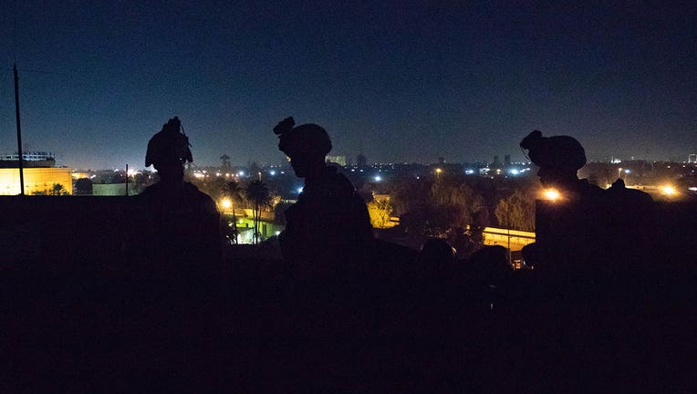 U.S. Marines with 2nd Battalion, 7th Marines, assigned to the Special Purpose Marine Air-Ground Task Force-Crisis Response-Central Command reinforce the Baghdad Embassy Compound in Iraq, Dec. 31, 2019.