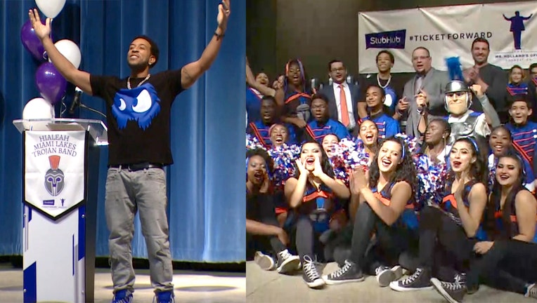 Rapper Ludacris surprises students at Hialeah-Miami Lakes Senior High School with $75,000 worth of musical instruments.