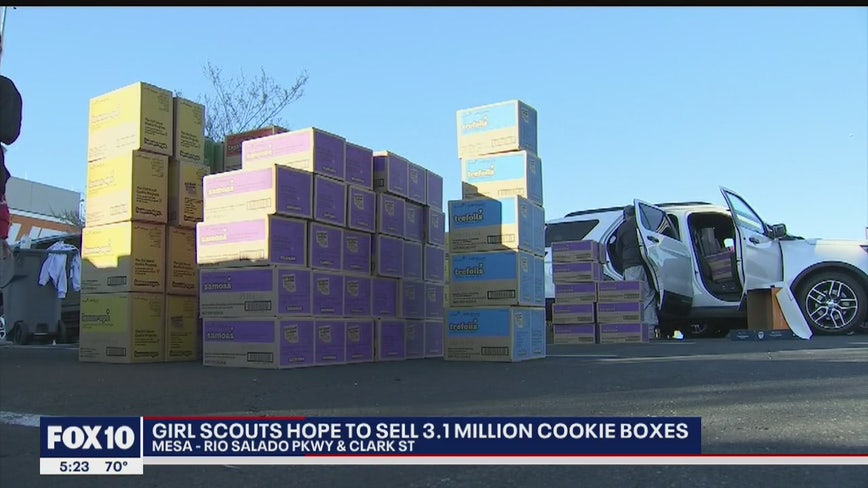 Valley Girl Scouts pick up cookies for delivery