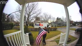 FedEx driver stops to pick up, fold fallen American flag