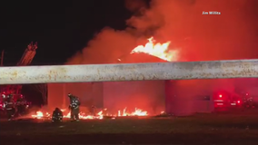 Debris from commercial building fire falls, injures Dallas firefighter