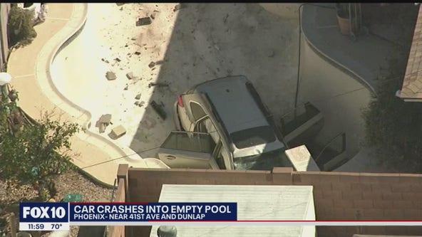 Car crashes slams through wall, crashes into empty Phoenix swimming pool
