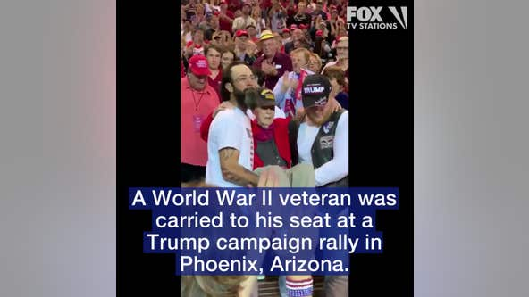 WWII veteran carried to his seat at a Trump campaign rally