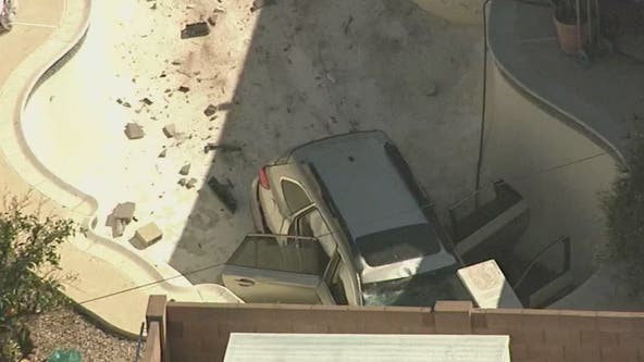 Car slams through wall, crashes into empty Phoenix swimming pool