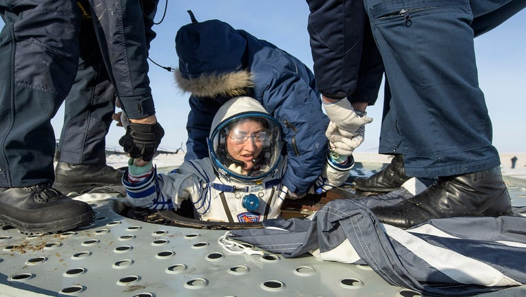 ZHEZKAZGAN, KAZAKHSTAN - FEBRUARY 6: In this handout image supplied by NASA, NASA astronaut Christina Koch is helped out of the Soyuz MS-13 spacecraft just minutes after she and her crewmates landed in a remote area near the town of Zhezkazgan, on February 6, 2020 in Kazakhstan.
