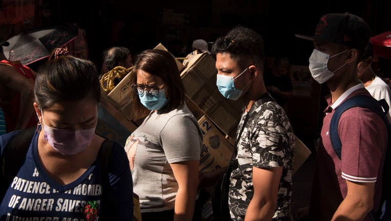 MANILA, LUZON, PHILIPPINES - 2020/02/02: Filipinos wearing face-masks following the virus outbreak. Fear continues to mount in the Philippines over a new corona virus known as 2019-nCoV which originated in Wuhan, China in December 2019. The Philippines Department of Health announced the countrys first case of the virus on 30th January. The number of 2019-nCoV cases worldwide has already surpassed that of the 2003 Sars epidemic. (Photo by Oliver Haynes/SOPA Images/LightRocket via Getty Images)