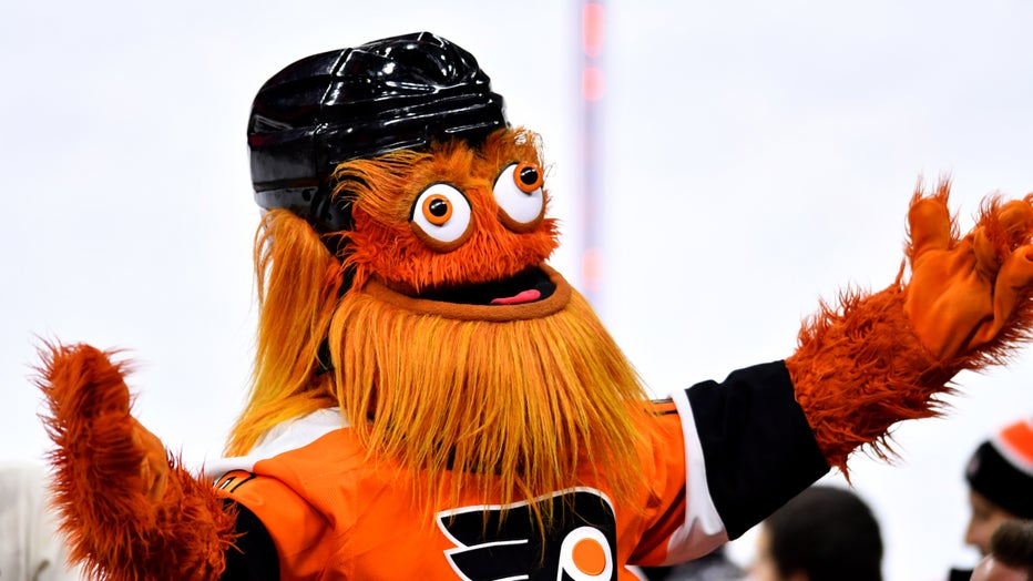 GETTY-Gritty-Hands-Up.jpg
