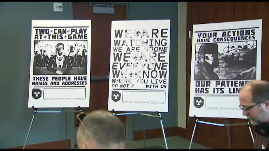 Neo-Nazi posters on display during a law enforcement news conference in February 2020