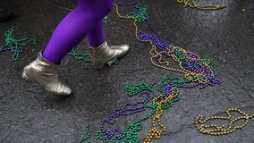 Brawl ensues after someone asks a woman to lift her shirt in exchange for Mardi Gras beads