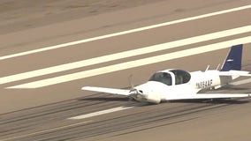 Small plane missing tire, landing gear makes emergency belly-landing at Goodyear Airport