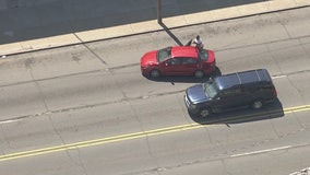 WATCH: Suspect stops to hand off baby in the middle of a Detroit Police chase