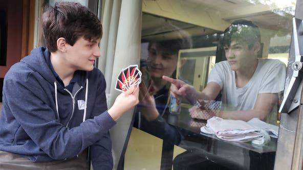 Florida family plays Uno with son through window of special-needs facility amid coronavirus lockdown