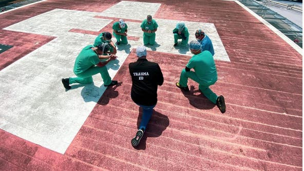 Nurses gather to pray on rooftops during coronavirus pandemic