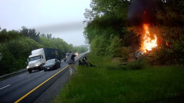 Dashcam video captures harrowing moment good Samaritan pulls passengers from fiery wreck
