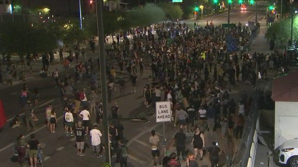 Protesters gather in front of Phoenix Police headquarters