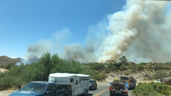 Fire crews battling 350-acre brush fire in Cave Creek; multiple homes on fire, evacuations underway