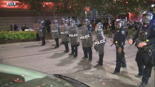 Protesters clash with Detroit police downtown; 1 demonstrator shot and killed in drive-by