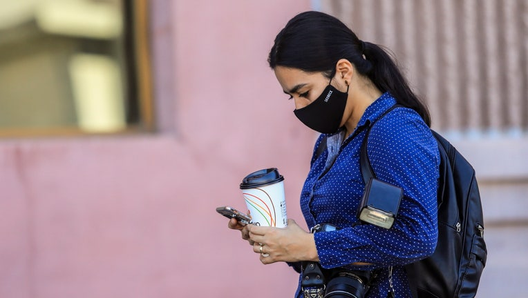 GettyImages-1226073989 mask phone