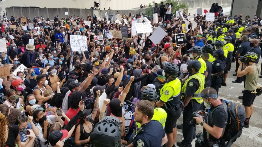 Demonstrators clash with police during Atlanta protest against death of George Floyd