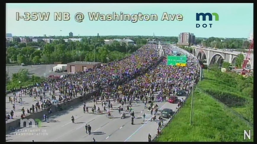 Live coverage: Truck barrels down I-35W as thousands of protesters pack highway