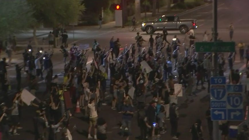 Unlawful assembly declared as protesters gather in front of Phoenix Police headquarters